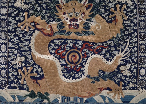 Blue ground metal thread embroidered textile with a dragon and the pearl of flames.